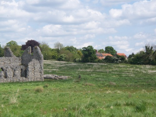 Castle Acre Priory with holiday cottage in background